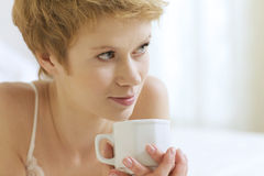 Woman drinking caffee Royalty Free Stock Photo