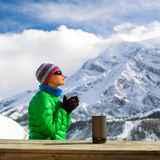 Woman drinking camping in mountains. Young woman hiker drink coffee or tea in beautiful Himalaya mountains on hiking trip, Nepal. Active person resting outdoors Royalty Free Stock Photos