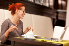 Woman drinking cappuccino Royalty Free Stock Photo