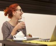 Woman drinking cappuccino Stock Photos