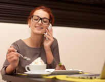 Woman drinking cappuccino Stock Image