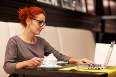 Woman drinking cappuccino Stock Images