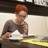 Woman drinking cappuccino Stock Photography