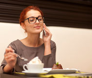 Woman drinking cappuccino Royalty Free Stock Images
