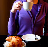 Woman drinking cappuccino at breakfast close-up Royalty Free Stock Photos