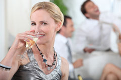 Woman drinking champagne Royalty Free Stock Image
