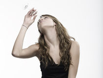 Woman drinking champagne Stock Images