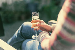 Woman drinking champagne at a festive event Royalty Free Stock Image