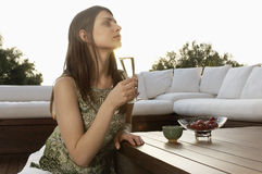 Woman Drinking Champagne Outdoors Royalty Free Stock Photo