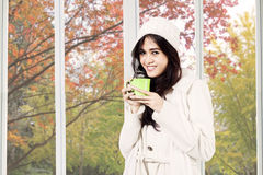 Woman drinking chocolate in autumn Stock Images