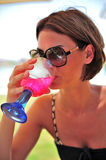 Woman drinking cocktail Royalty Free Stock Images