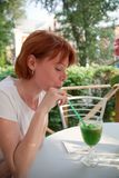 Woman drinking cocktail Stock Photography