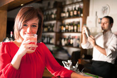 Woman drinking a cocktail Royalty Free Stock Image
