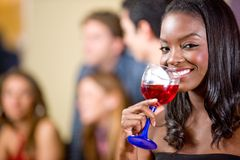 Woman drinking a cocktail Stock Photos