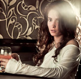 Woman drinking cocktail in cafe bar. Sad alone woman drinking cocktail in cafe bar Stock Images