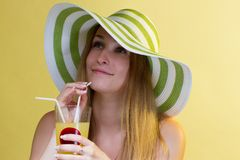 Woman drinking a cocktail Stock Photography
