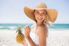 Woman drinking cocktail in pineapple. On the beach Royalty Free Stock Images