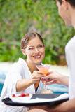 Woman drinking cocktail at pool of hotel Royalty Free Stock Photos