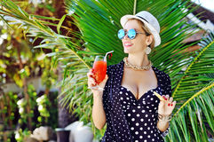 Woman drinking cocktail on a tropical beach Stock Photos