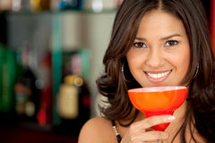 Woman drinking cocktails at a bar Royalty Free Stock Photography