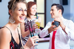 Woman drinking cocktails in cocktail bar Stock Photography
