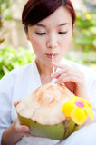 Woman Drinking Coconut Stock Photos