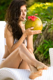 Woman drinking a coconut cocktail Royalty Free Stock Photography
