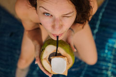 Woman drinking coconut . Happy carefree freedom girl in summer day. Top view Stock Photography