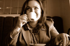 Woman drinking coffee. Woman drinking a cup of coffee Royalty Free Stock Image