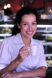Woman drinking a coffee. Coffee break: beautiful woman drinking an expresso at a cafe stock photos