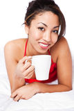 Woman drinking coffee Stock Images