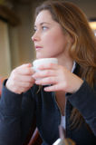 Woman is drinking coffee Stock Image