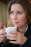 Woman is drinking coffee Royalty Free Stock Photo