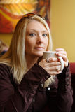 Woman drinking coffee. Young lady enjoying a mug of coffee stock photo