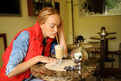 Woman drinking coffee. Woman drinking cappuccino in  cafe Stock Photo