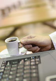 Woman drinking coffee. At work Stock Image