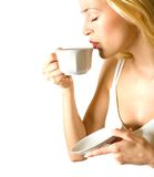 Woman drinking coffee royalty free stock photos