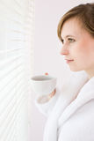 Woman drinking coffee Stock Image