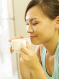 Woman drinking coffee Royalty Free Stock Images