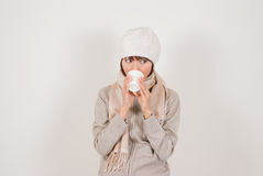 Woman drinking coffee. Young woman wearing knit hat drinking coffee Royalty Free Stock Photography