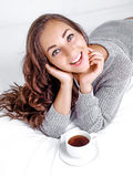 Woman drinking coffee. Beautiful young woman driniking coffee in bed at home Royalty Free Stock Photo