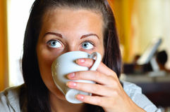 Woman is drinking coffee in cafe Stock Photo