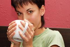 Woman drinking coffee in cafe Royalty Free Stock Photo