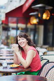 Woman drinking coffee in cafe Stock Images