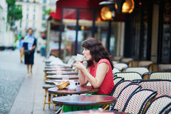 Woman drinking coffee in cafe Stock Photo