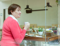 Woman drinking coffee in   cafe. Stock Image