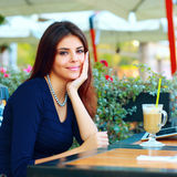 Woman drinking coffee at cafe Royalty Free Stock Image