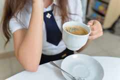 Woman drinking coffee at cafe, hands holding cup of hot drink Stock Image