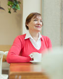 Woman drinking coffee in   cafe. Royalty Free Stock Photos