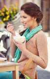 Woman drinking coffee in a cafe on the streets Stock Photos